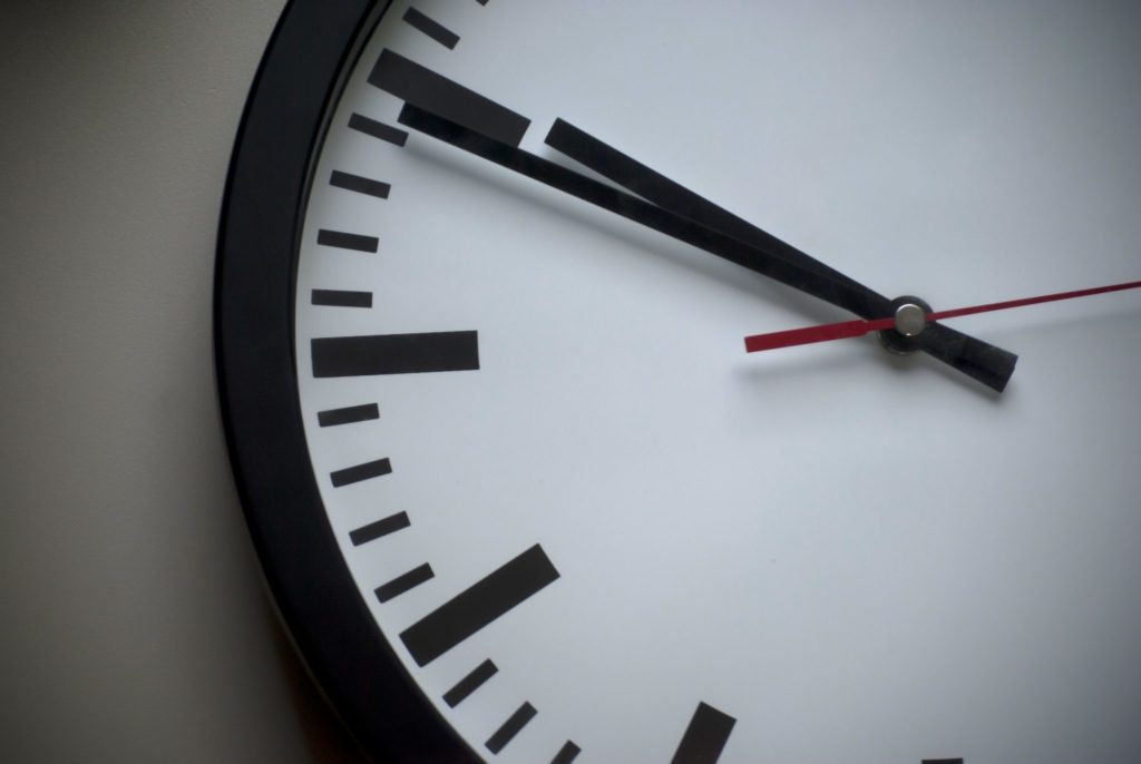 Picture of a clock taking up the whole frame, pointing to 10:50.