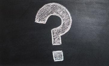 Large chalk question mark on a blackboard