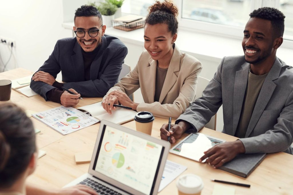 Employees reviewing HR tech trends