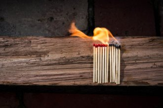 Bundle of matches catching fire from other lit matches.