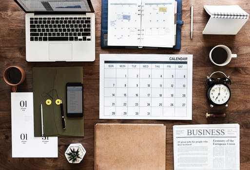 desk with calendar and documents.