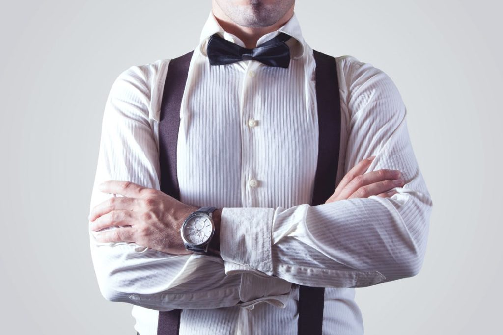 Guy wearing a longsleeve shirt and bow tie, dressed in business wear