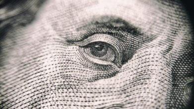 close up of bejamin franklin's eye on $100 bill